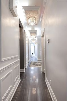 Dark wood floors, White trim walls, lots of light, ceiling trim around lights--love it all!