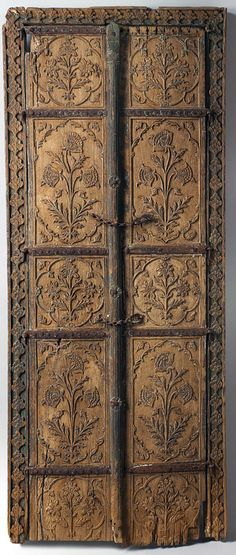 Pair of flower style doors, 17th century. India. Wood | The flower style associated with the height of Mughal aesthetics and refinement finds expression in this pair of carved wood doors.