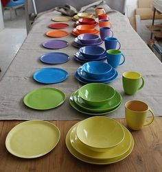 Beautiful dishware, I like the flat plates and that the shapes aren't perfect. Also, a bowl-plate is always a must in my dish collection. Replacement Dishes, Yellow Bowls, Porcelain Dinnerware, Colorful Garden, Orange And Purple, Blue Green, Fine Porcelain, Ceramic Plates, Handmade Pottery