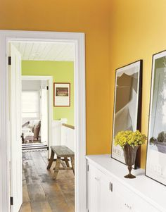 Love the mango colored walls in this hallway. The (built in?) cabinets are the perfect size for the narrow space.