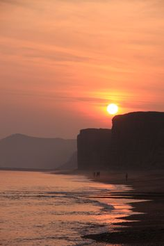 The sun setting over Burton Bradstock