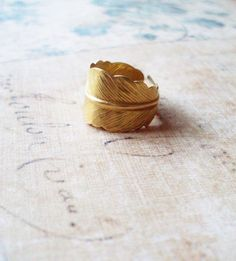 The Golden Feather Gold Feather Ring Cute by dreamsbythesea. $46.00, via Etsy.