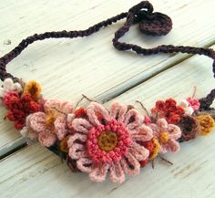 Just wonderfully touchable!  ..and the colours are perfect!  Pink & Brown Flower Crochet Necklace by meekssandygirl via Flickr
