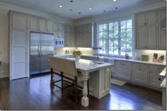 love everything about this kitchen-- maybe fewer upper cabinets