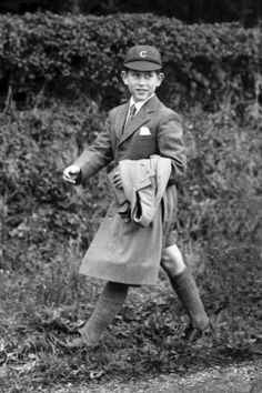 In the nine-year-old Prince Charles strides off to Cheam School in Berkshire in his smart blazer, shirt and tie, shorts, long socks and cap. The picture was taken the day after the Queen gave her eldest son the title the Prince of Wales.