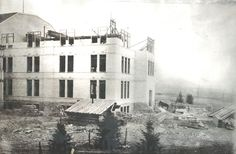 Logan Library - Historic Photo Collection: Construction of Old Main Tower. Date: 1901.  Address: Utah State University Campus. Old Main was designed by C. T. Thompson to be built in three stages. It was constructed between 1889 and 1902. The north wing and east part of the central section were built in 1892 - 1893. The west tower (shown under construction) was completed in 1901-02. Utah Agricultural College because Utah State University in 1957. Source: Logan Library Photo Collection.