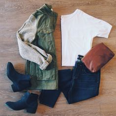 Neutral layers with army jacket white T shirt jeans black booties and small brown leather clutch