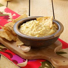 Lick-the-Bowl-Clean Hummus Recipe -Everyone loves hummus, but I enjoy the garlic and onion types so much that I decided to let them shine in this homemade version. I get so many compliments when I serve it! —Sarah Gilbert, Beaverton, Oregon