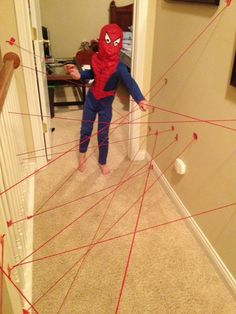 """Forget for the kids, I want to do this!  """"Just red yarn for the """"lasers"""" and then tape them to the wall with duct tape (both from Hobby Lobby) and then they can crawl through and under and over!"""""""
