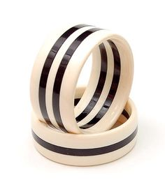 FASHION JEWELRY - Two wide bakelite black/white bracelets design execution unknown ca.1970