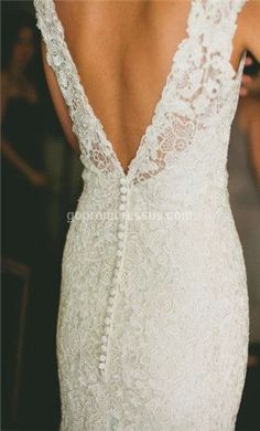 an interesting back gives this lace wedding dress a unique twist