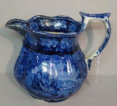 99: HISTORICAL BLUE STAFFORDSHIRE PITCHER. Bulbous pitc