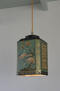 Tin Can Light This great idea comes from Hans Groenwold. Look up his work! The lights are made from vintage tins. Maybe it would just be easier to buy one of his impeccable made lights! Tin Can Lights, Lampe Decoration, Thrift Store Crafts, Vintage Tins, Vintage Style, Lamp Shades, Pendant Lamp, Lamp Light, Diy Furniture