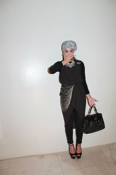 Like the outfit...this is NOT an acceptable way to wear the  hijab!