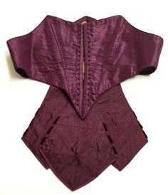 Mid- to late 1860s plum silk shaped belt with peplum, trimmed with velvet. Cotton lining. Fenimore Art Museum.