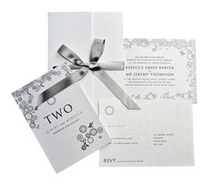 Classy crystal and white wedding invitations.