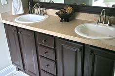 Painted bathroom vanity with Rustoleum Cabinet Transformations.  I am thinking of doing this with light turquoise walls. Pretty Pretty Pretty!