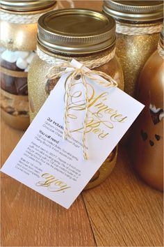 S'mores Bars In DIY Glitter Mason Jars! The perfect holiday gift or wedding favor that is sure to impress.
