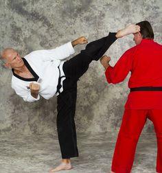 black-belt-photo-bill-wallace-head-kick