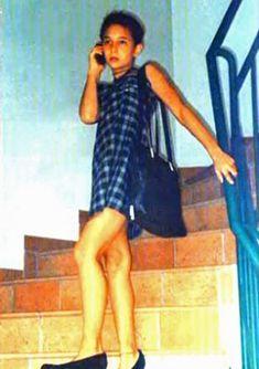 Wearing high heels, a checked dress and handbag, Thomas Neuwirth would only dress up at hi...