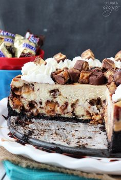 Snickers Cheesecake - vanilla cheesecake filled with Snickers and a chocolate and caramel swirl
