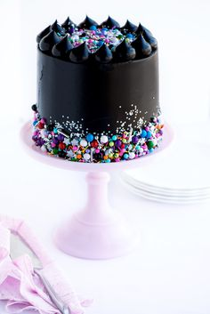 Glam Rock Layer Cake by Sweetapolita....she makes the most beautiful cakes.  I love her frosting drops on the top and fun sprinkles she always uses..