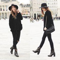 {Street style}   Black hat, black fur cardigan, black tee, black distressed jeans, black ankle boots, black chain link bag.