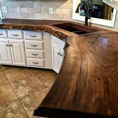 Maybe with a vessel sink in bathroom - Solid wood counter top. Traditional, classy and very unique! Absolutely stunning!