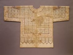 This talismanic shirt was believed to be imbued with protective powers and may have been meant to be worn under armor in battle. Its surface is decorated with painted squares, medallions, and lappet-shaped sections with the entire Qur'an written inside; these areas are bordered by the ninety-nine names of God written in gold against an orange background. Talismanic Shirt  Object Name:Shirt Date:15th–early 16th century Geography:Northern India or Deccan