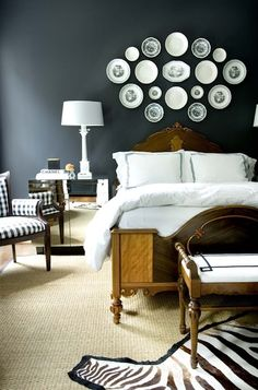 Courtney Giles: a bold bedroom design with black walls, antique wood bed and… Dark Walls, Grey Walls, Wood Beds, Plates On Wall, Plate Wall, Hanging Plates, Paint Plates, How To Antique Wood, Antique Bench