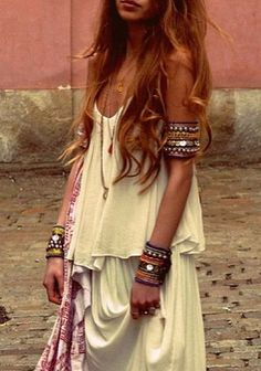 Loose Bohemian dress, modern hippie jewelry, gypsy bangles, bracelet & cuffs, boho chic rings. For MORE fashion trends FOLLOW http://www.pinterest.com/happygolicky/the-best-boho-chic-fashion-bohemian-jewelry-gypsy-/