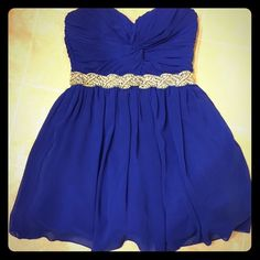 Royal Blue Short Formal Dress! Royal blue short formal dress! Beautiful chiffon dress with rhinestone accents! Strapless sweetheart neckline! Had tulle underneath to help fill the dress out! Only worn once! Size 7 but runs small! Deb Dresses Strapless