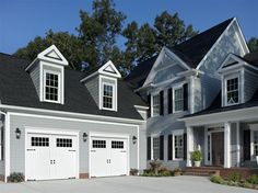 Amarr Classica® Cortona garage door in True White with Madeira Windows and optional Versailles handles and straps. Visit www.amarr.com for more great styles.