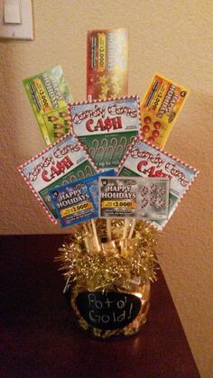 Pot of gold lottery ticket bouquet. Gift idea Fill bottom with golden candies like Chocolate coins if you can find them, or Werther's, or Hershey's Raffle Baskets, Gift Baskets, Valentine Gifts, Holiday Gifts, Valentines Flowers, Homemade Gifts, Diy Gifts, Lottery Ticket Gift, Auction Baskets