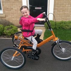 Izzy  on her new trike.. How happy she is!! Thanks @actionforkids for this beautiful photo