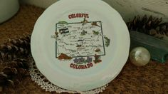 Check out this item in my Etsy shop https://www.etsy.com/listing/276778230/retro-colorado-souvenir-plate-kitsch