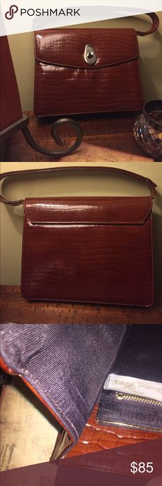 Vintage Monsieur Heni Purse Purchased in Italy late 60's. Beautiful bag. Clasp section needs polishing, but leather is gorgeous walnut color with no visible damage. One tiny white spot by clasp. Bags