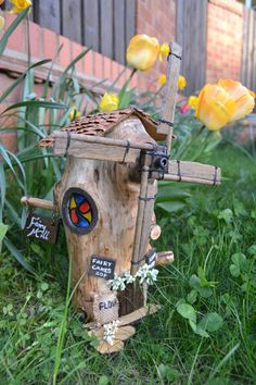 Beautiful hand made Fairy Tree Windmill, made using wood from a fallen tree. This fairy windmill is approximately wide and high to the tip of the windvane. The windvane turns and is a lovely rustic feature in the wind. The house has lots . Garden Windmill, Fairy Houses, Tree Houses, Fairy Tree, Fairy Cakes, Woodland Garden, Fairy Garden Accessories, Garden Inspiration, Garden Ideas