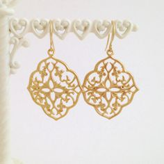 A personal favorite from my Etsy shop https://www.etsy.com/listing/286387239/gold-abstract-floral-dangle-earring