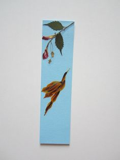 """Handmade unique bookmark """"Bodybuilder"""" - Decorated with dried pressed flowers and herbs - Original art collage."""