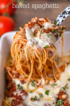 Cheesy Baked Spaghetti - a simple, delicious, dinner recipe filled with hamburger, sausage, cheese and more! Everyone will love this dinner recipe!