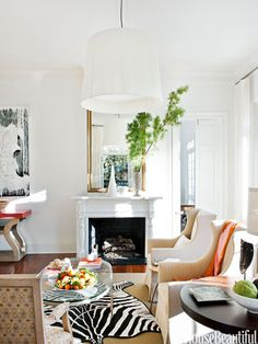 White walls lifted a dark 1820s New Orleans cottage to light and cheery and give the house a buoyant, happy feeling.