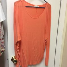 Peach super comfortable shirt! Very cute with just about anything! Not tight fitting. Fits loose! Never been worn, just tried on at the store. Has hung in my closet since purchased. Tops Blouses