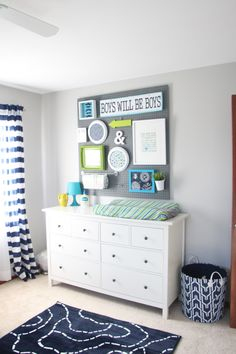 DIY nursery wall decor | navy green and gray baby's room | nursery pegboard gallery wall