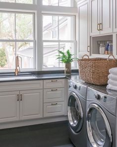 How do you make a laundry room fresh and clean? Display clean and folded towels on shelves or in baskets! Design by Palmetto Cabinet Studio