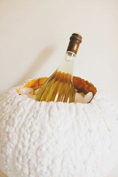 Pumpkin Champagne Ice Bucket: How creative! Instead of carving a pumpkin, put it to party use by spray-painting it white and filling it with ice to create a Champagne bucket. Photo by Rebecca Hansen Weddings via Style Me Pretty Happy Halloween, Halloween Dinner, Holidays Halloween, Halloween Decorations, Fall Decorations, Halloween Crafts, Halloween Table, Halloween 2015, Scary Halloween
