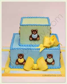 If having a teddy bear baby shower we thought this cute cake with teddy bears is super cute and would go great with the theme.