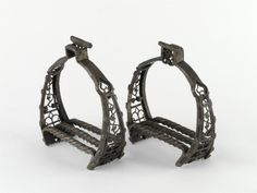 Pair of wrought iron stirrups, with a mark comprising a winged cross?, Germany, early 16th century