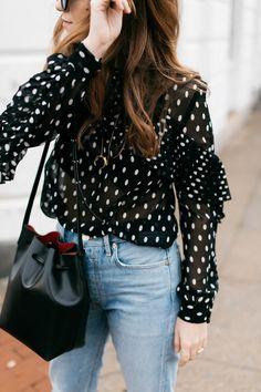 Polka dot blouse, denim, leather bag, crescent necklace