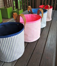 Fabric bins in ticking stripe canvas with leather handles and rivets - so cool to make!